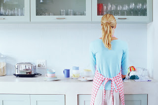 Woman washing up --- Image by © Royalty-Free/Corbis