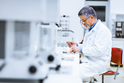 Senior male researcher carrying out scientific research in a lab
