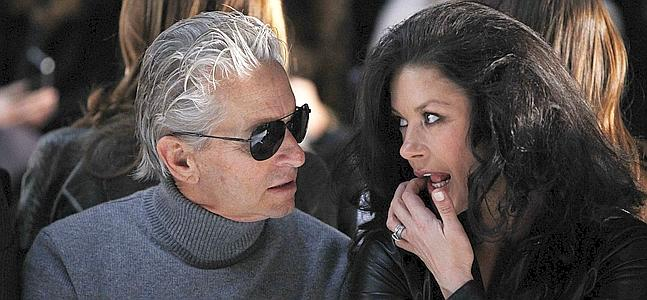 DOCU_GRUPO Actors Michael Douglas and Catherine Zeta-Jones talk as they attend a showing of the Michael Kors Fall/Winter 2011 collection during New York Fashion Week