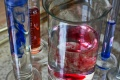 Red and blue substances in transparent test tubes